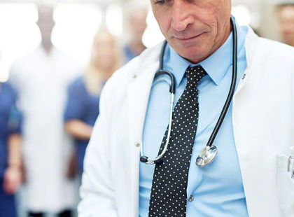 The medicine specialist with tablet in hospital
